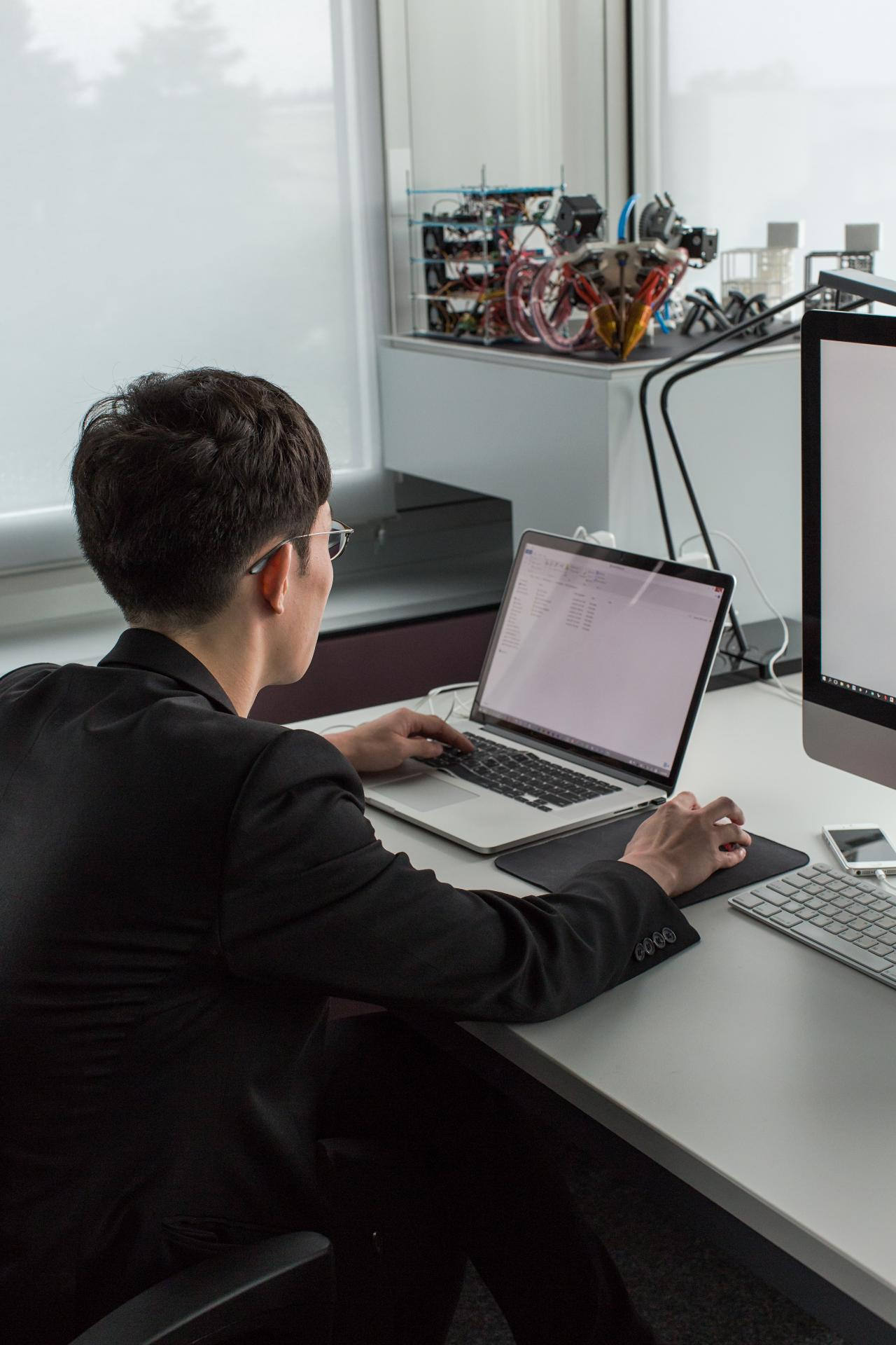 man infront of computer
